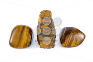 Tiger's eye rough and tumbled close up white background - Popular Stock Photos