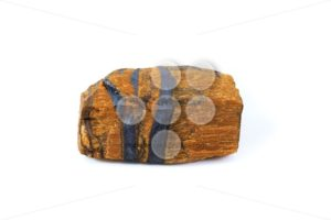 Tiger's eye rough gemstone close up white background - Popular Stock Photos