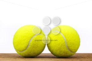 Two tennis balls table wood isolated - Popular Stock Photos
