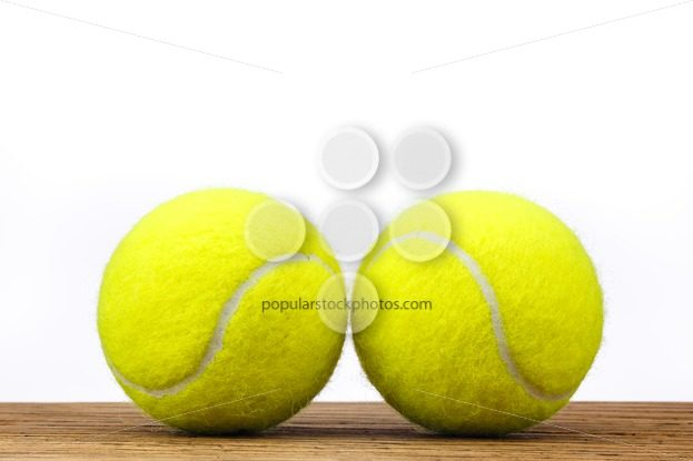 Two tennis balls table wood isolated – Popular Stock Photos
