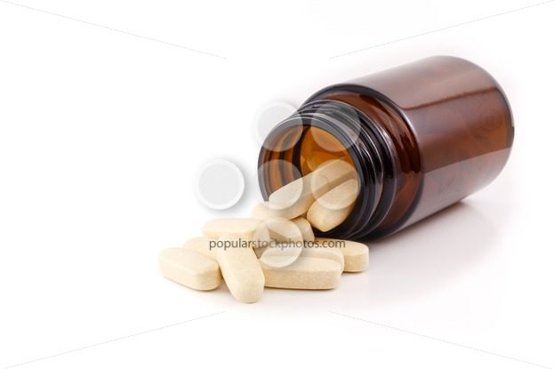 Vitamin pills view brown bottle on side – Popular Stock Photos