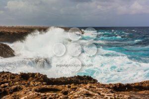 Waves splashing on rocks Bonaire - Popular Stock Photos