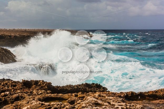 Waves splashing on rocks Bonaire – Popular Stock Photos