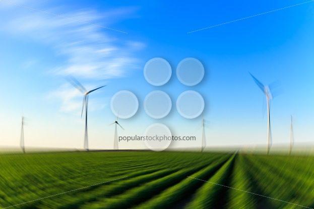 Windmills field of crops blur radial – Popular Stock Photos