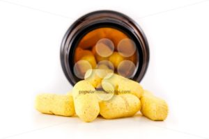Yellow pills view inside brown bottle - Popular Stock Photos
