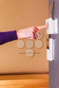 Young male hand thermostat clean purple - Popular Stock Photos