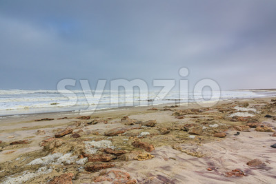 Dark sky beach skeleton coast Namibia Stock Photo