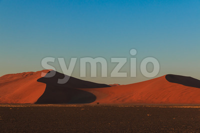 Mighty red sand dune at sunset Sossusvlei Stock Photo