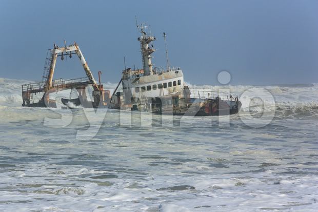 Shipwreck in waves Stock Photo