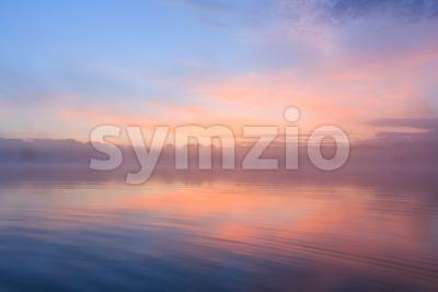 Misty sunrise lake France Stock Photo