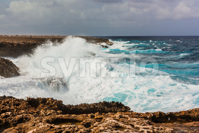 Waves splashing on rocks Bonaire Stock Photo