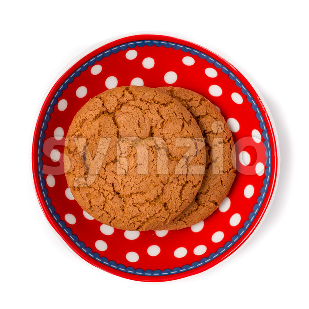 Ginger cookies on red white dotted dish isolated on white backgr Stock Photo