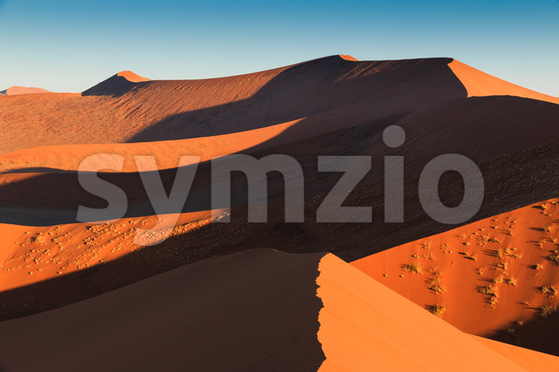 Walking to end of red sanddune Sossusvlei Stock Photo