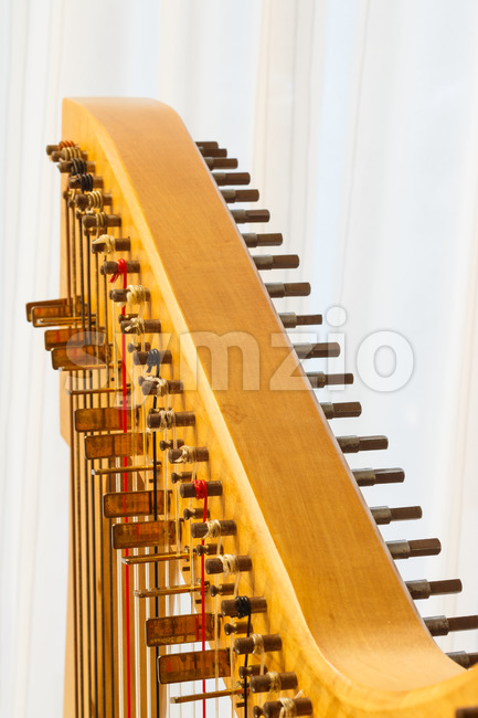 Close up of the string adjustment of a Celtic harp.