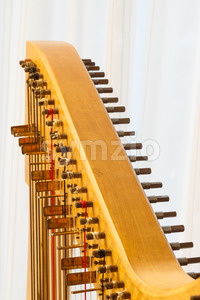 Celtic harp close-up string adjustment Stock Photo