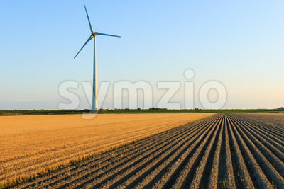 Windmill at farmer fields Stock Photo