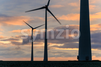 Huge windmill in motion at sunset Stock Photo