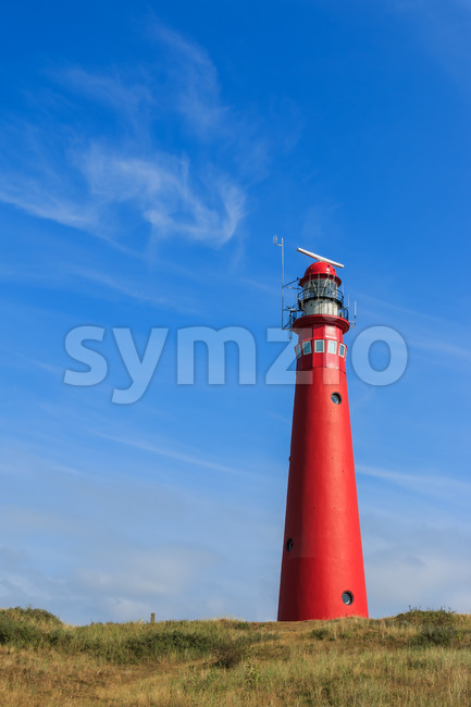 Red lighthouse landscape Stock Photo