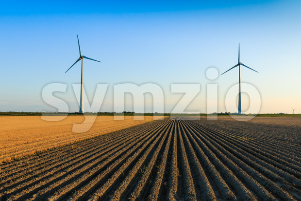Windmills at farmer fields Stock Photo