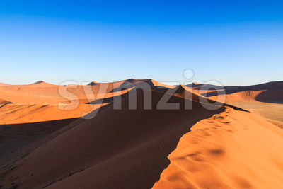 Walking to top red sanddune Sossusvlei Stock Photo