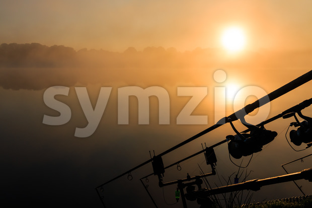 Carp fishing rods misty lake France Stock Photo