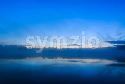 Sun rising over lake France Stock Photo