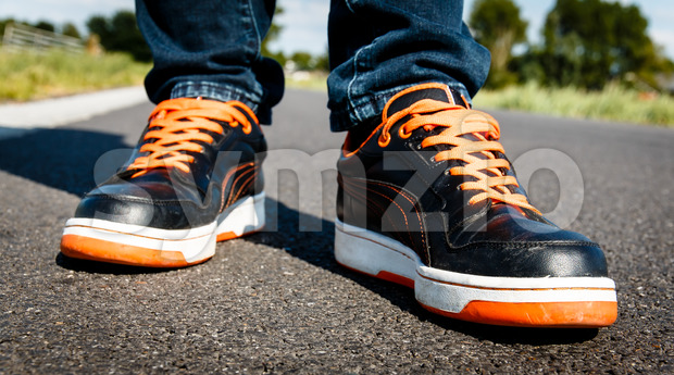 Orange black sport shoes, on the move Stock Photo