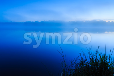 Just before sunrise lake France Stock Photo