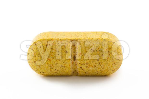 Close up yellow pill Stock Photo