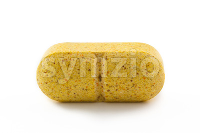 Close up yellow pill Stock Photo