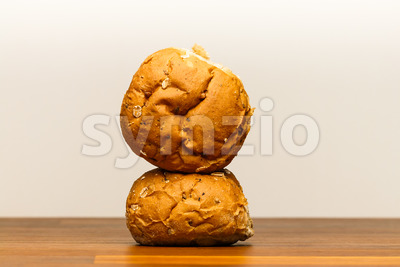 Two spelt buns one on side Stock Photo
