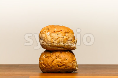 Two spelt buns stacked Stock Photo