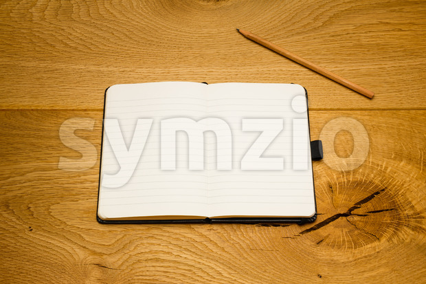 Empty pages notebook pencil above textbook copy space Stock Photo