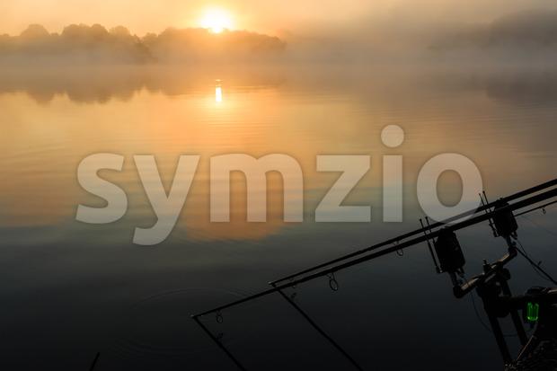 Carp rods misty lake France Stock Photo