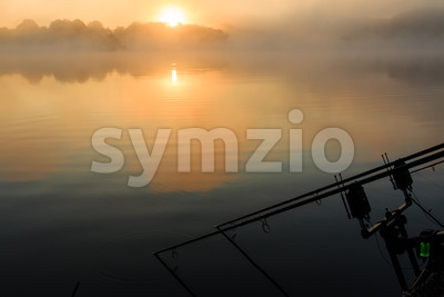 Carp rods misty lake France Stock Photo