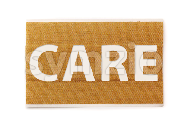 Strip of band aid with text care cut out, isolated on a white background. Healthcare, hospital, cure, care, relief.