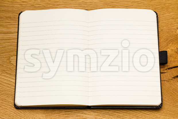 Close up of empty pages of a notebook on a desk. Make the notes for your business. Space for copy ...