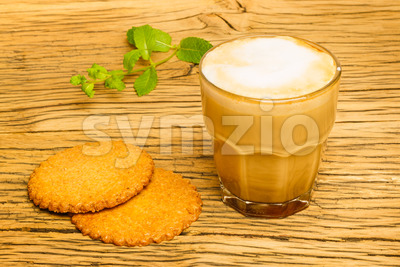 Cookie and cappuccino kitchen table oak Stock Photo