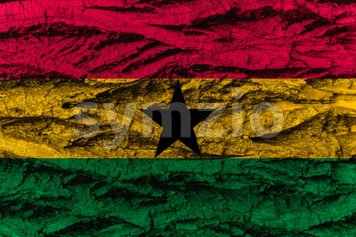Ghana national flag painted wooden bark tree Stock Photo
