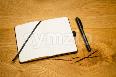 Empty pages notebook marker skew on desk Stock Photo