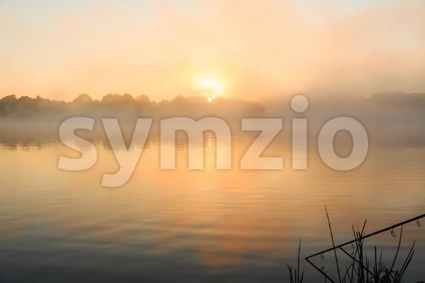 Carp fishing misty lake France Stock Photo