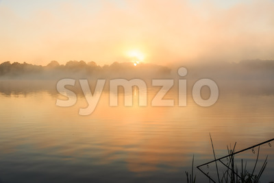 Carp fishing misty lake France Stock Photo