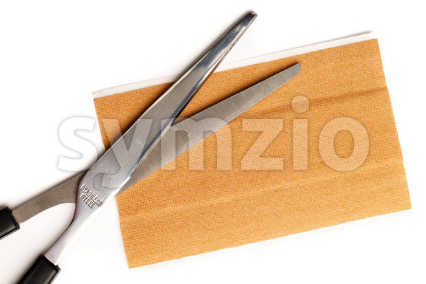 Band aid strip scissors isolated white Stock Photo