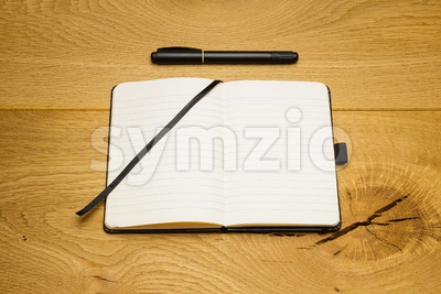 Empty pages notebook marker on desk Stock Photo