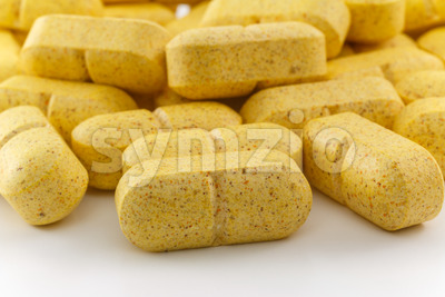 Close up several yellow pills Stock Photo