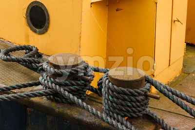Boat secured with ropes Stock Photo