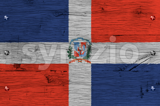 Dominican Republic national flag with coat of arms. Painting is colorful on wood of old train carriage. Fastened by screws ...