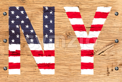 NY painted with pattern of flag United States old oak wood fastened Stock Photo