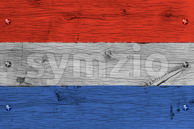 The Netherlands, Dutch national flag. Painting is colorful on wood of old train carriage. Fastened by screws or bolts.