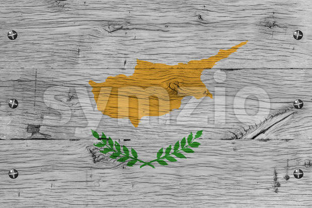Cyprus national flag. Painting is colorful on wood of old train carriage. Fastened by screws or bolts.
